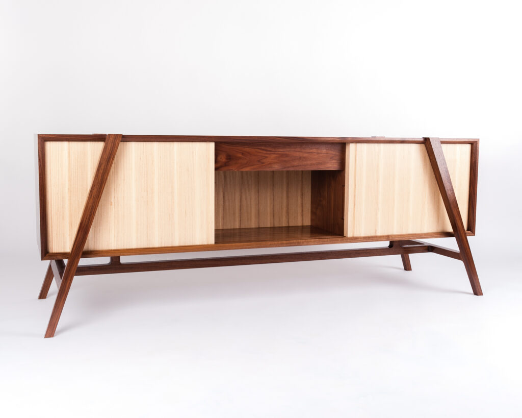 A CABINET IN WALNUT AND ASH VENEER, MADE BY A STUDENT ON A FINE WOODWORKING COURSE AT ROWDEN ATELIER