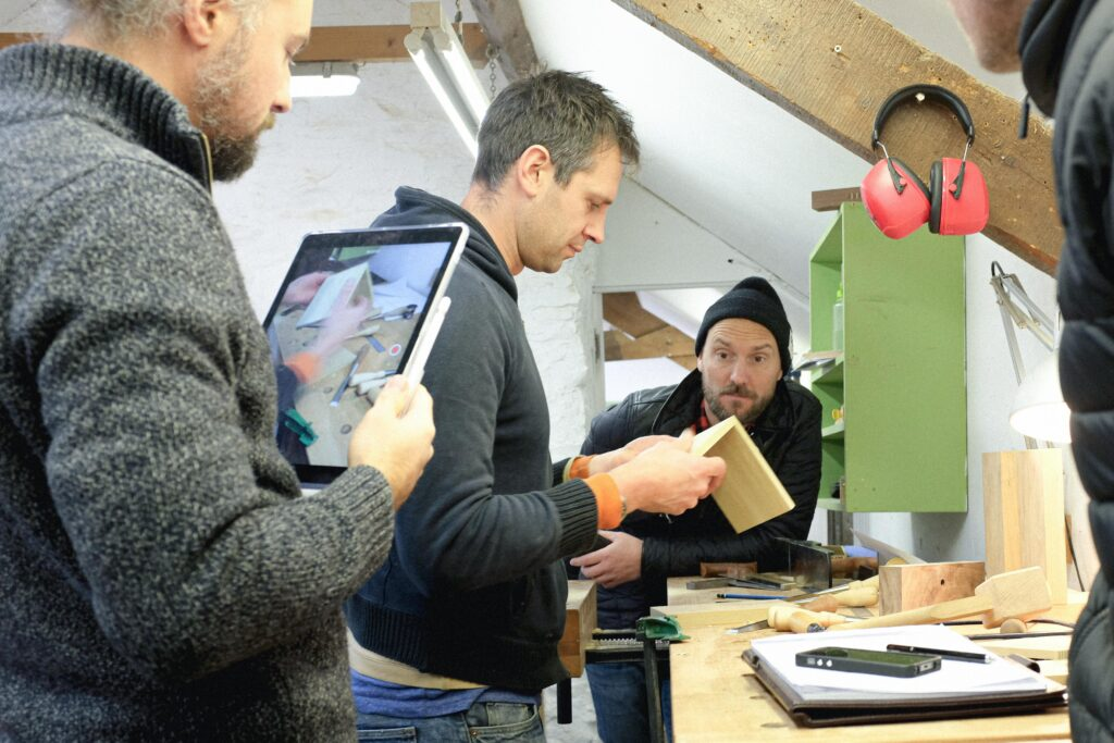ROWDEN TUTOR ED WILD SHOWING STUDENTS THE BASICS ON OUR WOODWORKING COURSES AT ROWDEN ATELIER