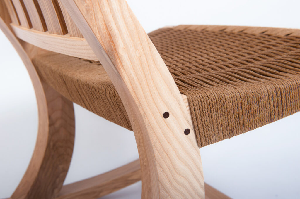 A CLOSEUP OF THE CORD WOVEN SEAT ON A ROCKING CHAIR MADE ON A FINE FURNITURE MAKING COURSE AT ROWDEN ATELIER