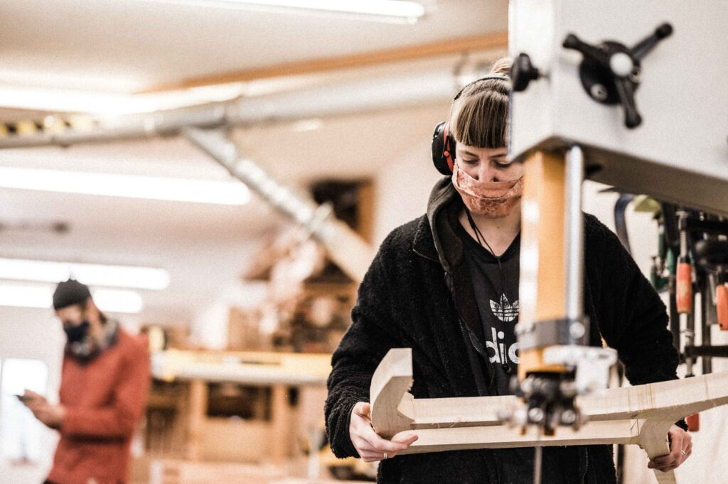 A ROWDEN STUDENT WORKING ON A FURNITURE COMPONENT AS PART OF A FINE FURNITURE MAKING COURSE AT ROWDEN ATELIER