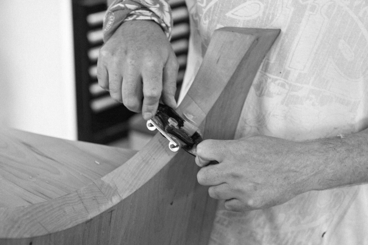 CLOSEUP OF A SPOKESHAVE IN USE AT ROWDEN ATELIER ON A WOODWORKING COURSES