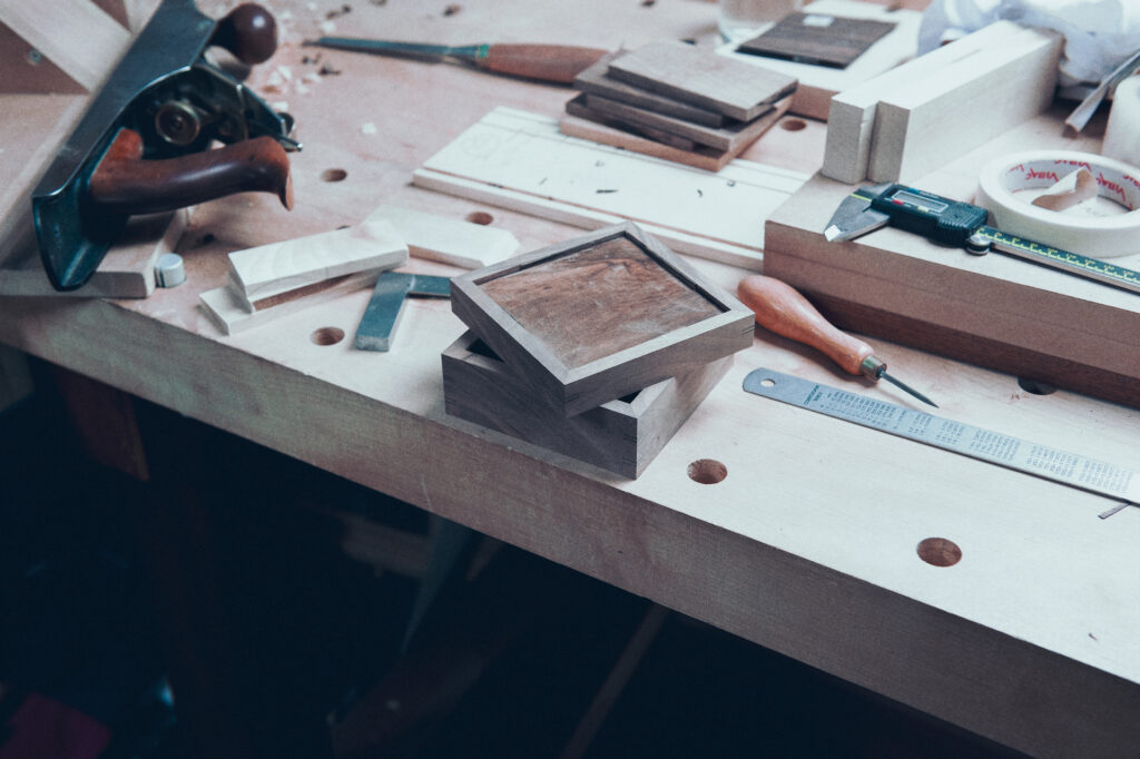a small box and hand tools on the workbench at Rowden Atelier