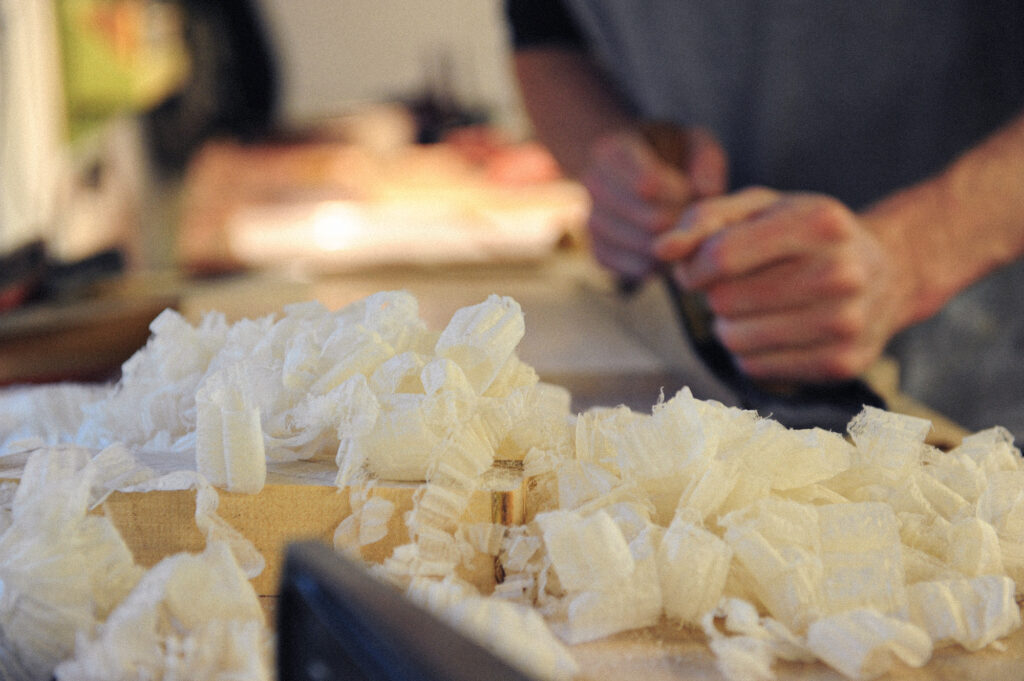 shavings from a hand plane, in use on a Rowden Atelier furniture design course