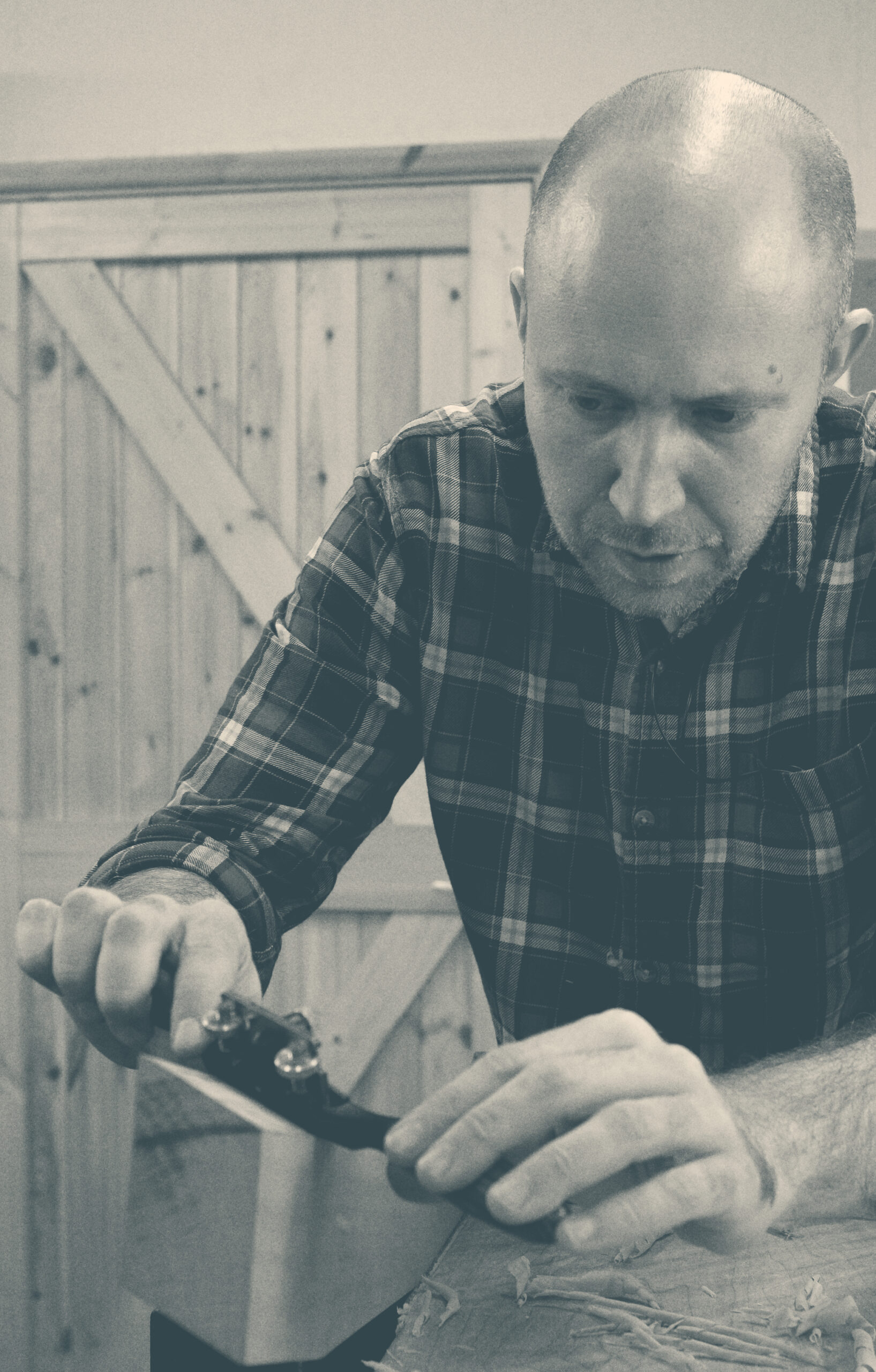Furniture Designer/Maker and woodworker using a spokeshave to shape a component