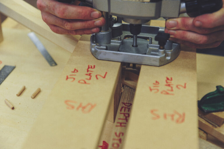 a closeup of a router being used by a student on timber for furniture making at Rowden Atelier