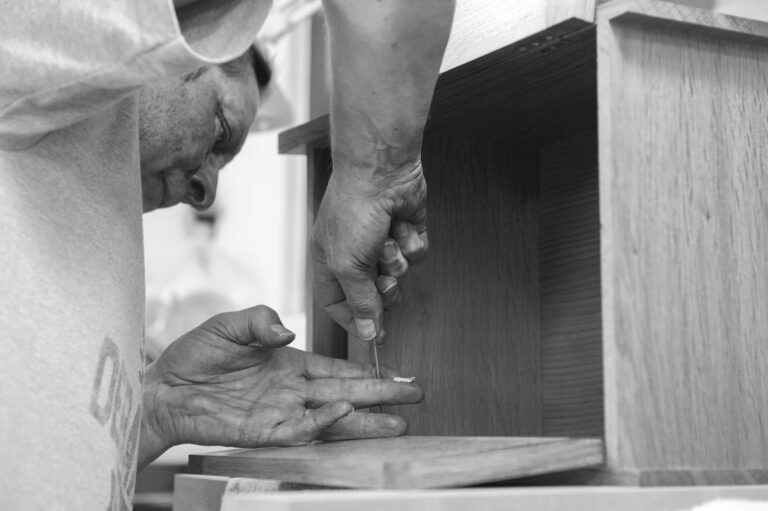 a student attending one of the Rowden woodworking courses, making a cabinet