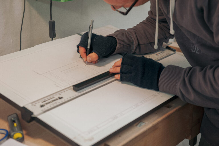 a student doing scale drawing of furniture on their Rowden Atelier furniture design courses