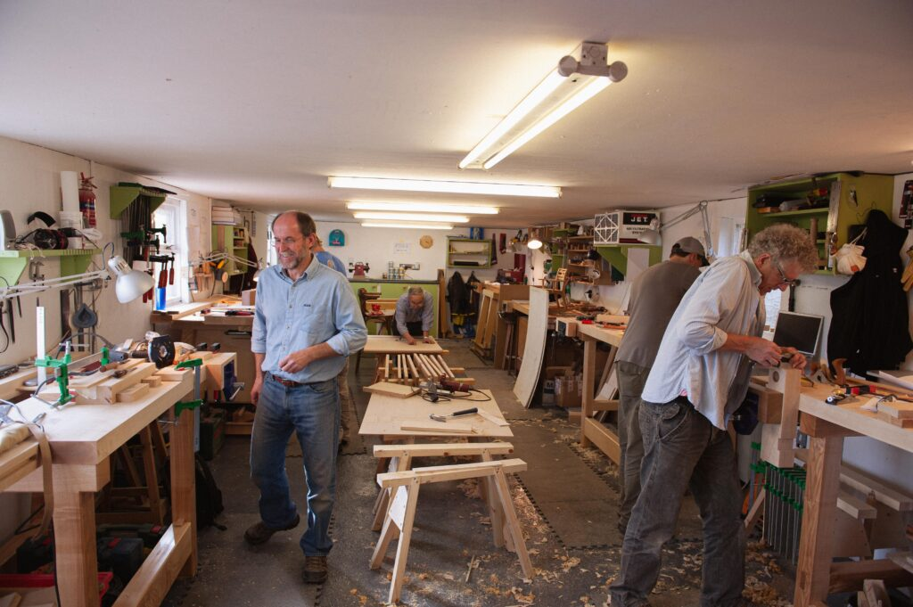 students in the workshop, at their workbenches, at Rowden Atelier