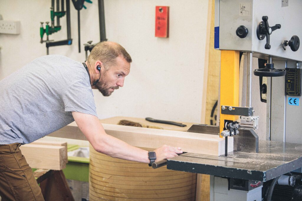 Rowden student using the bandsaw in a fine woodworking course