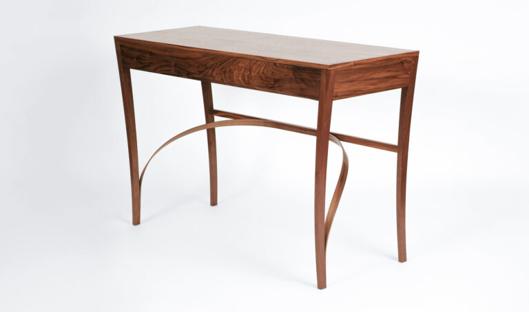 A sideboard table in walnut with laminated underframe, made at Rowden Atelier on a woodworking course