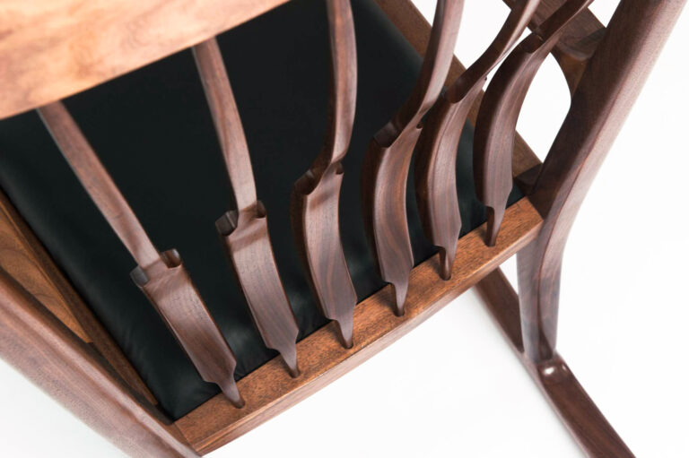 detail of a walnut Sam Maloof style rocking chair made by a Rowden student on our woodworking courses