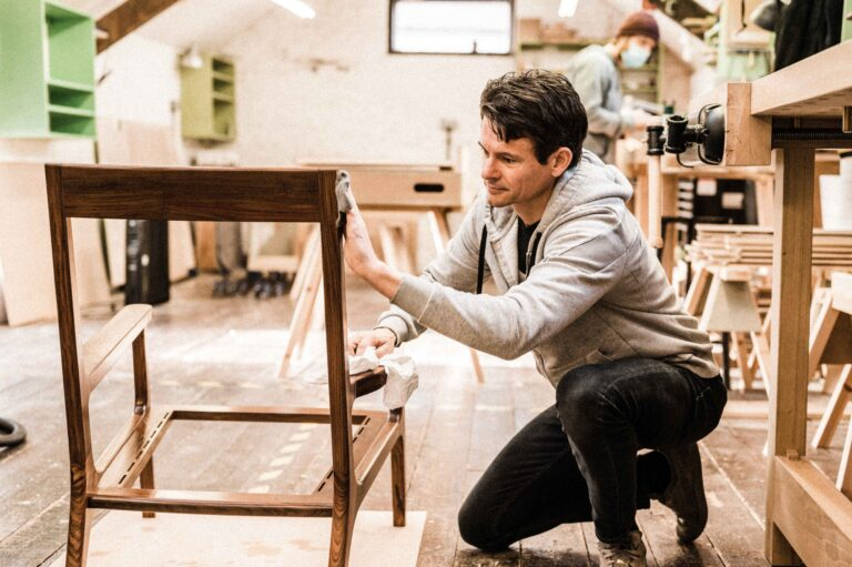 A Rowden student putting an oil finish on a custom made chair. The piece was made as part of a furniture design course, at Rowden Atelier