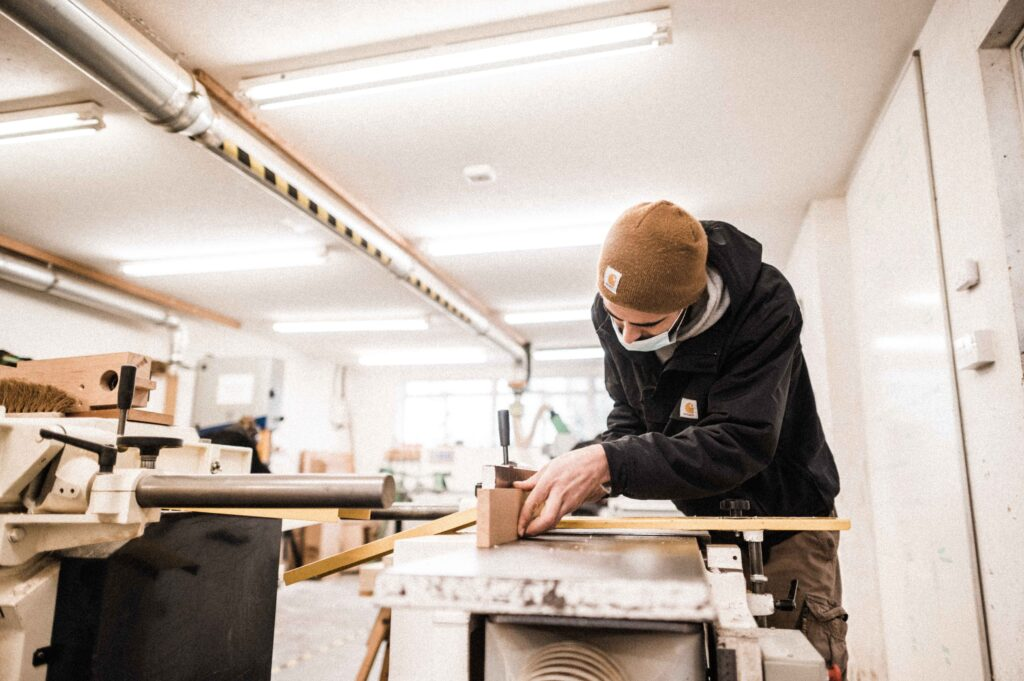 A student machining a furniture component as part of a furniture making course at Rowden Atelier