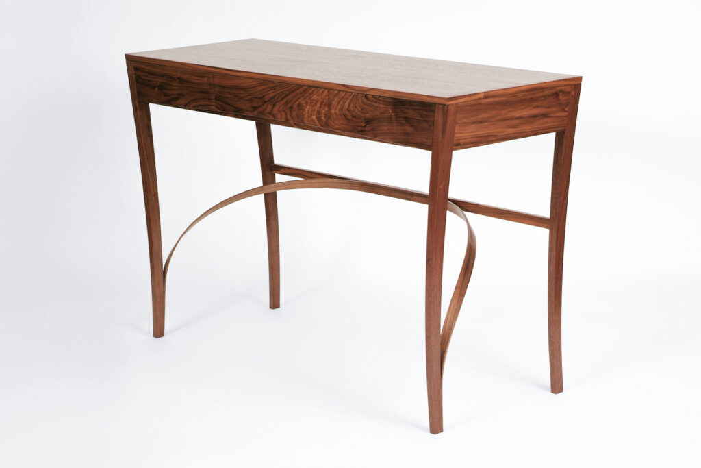 A sideboard table in walnut with laminated underframe, made at Rowden Atelier on a fine furniture making course