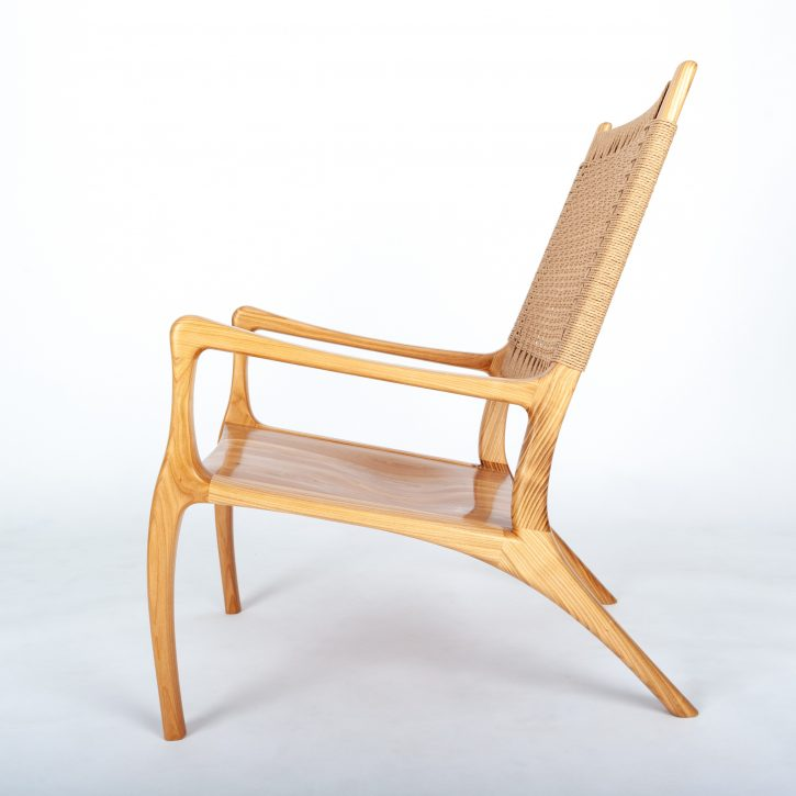 A chair in cherry wood, with a danish cord back, made on a furniture making course at Rowden Atelier
