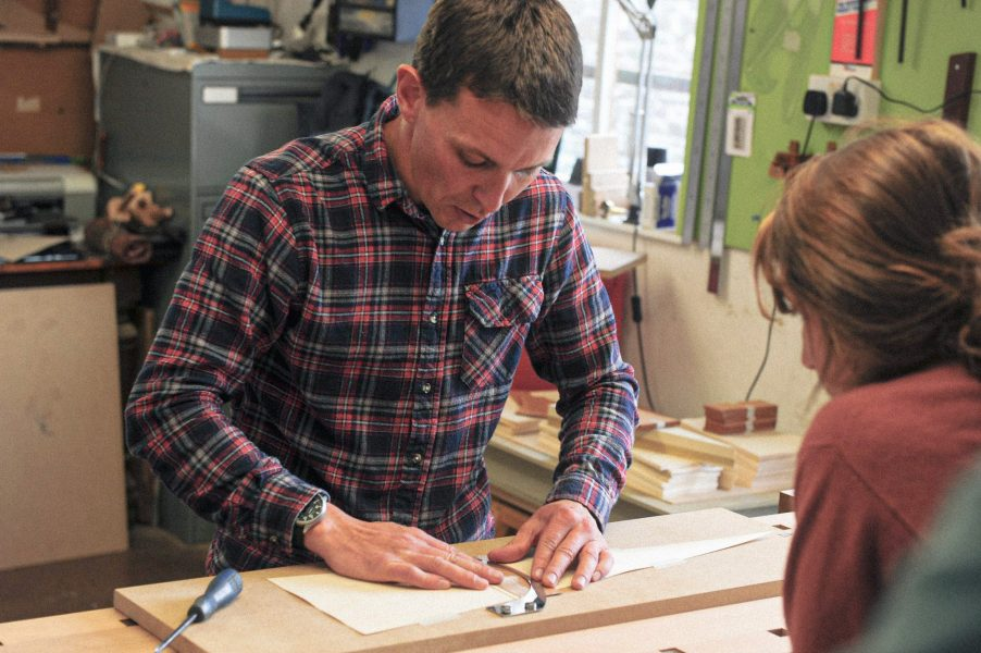 tutor at Rowden Atelier, Daren Millman showing a student part of the process in sunburst veneering as part of a woodworking course at Rowden Atelier