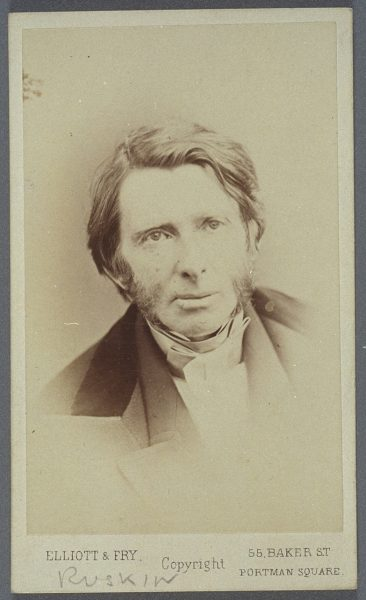 A portrait photograph of the artist John Ruskin